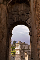 The Arch of Constantine through an arch of the Colosseum