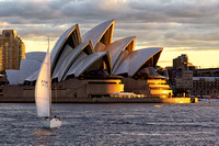 Sydney Opera House with Sail Boat at Sunset
