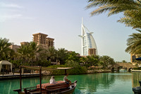 Madinat Jumeirah waterway with boat and Burj Al Arab, Dubai