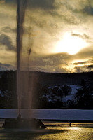 Fountain in winter sunset